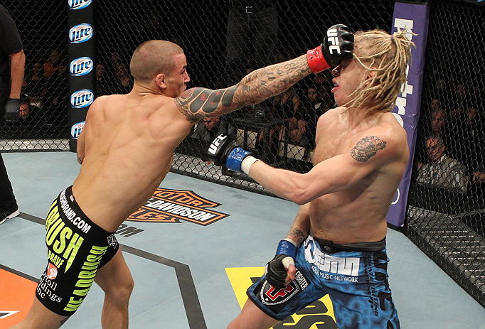 LAS VEGAS, NV - DECEMBER 15:  (L-R) Dustin Poirier punches Jonathan Brookins during their featherweight fight at the TUF 16 Finale on December 15, 2012  at the Joint at the Hard Rock in Las Vegas, Nevada.  (Photo by Jim Kemper/Zuffa LLC/Zuffa LLC via Getty Images) *** Local Caption *** Dustn Poirier; Jonathan Brookins