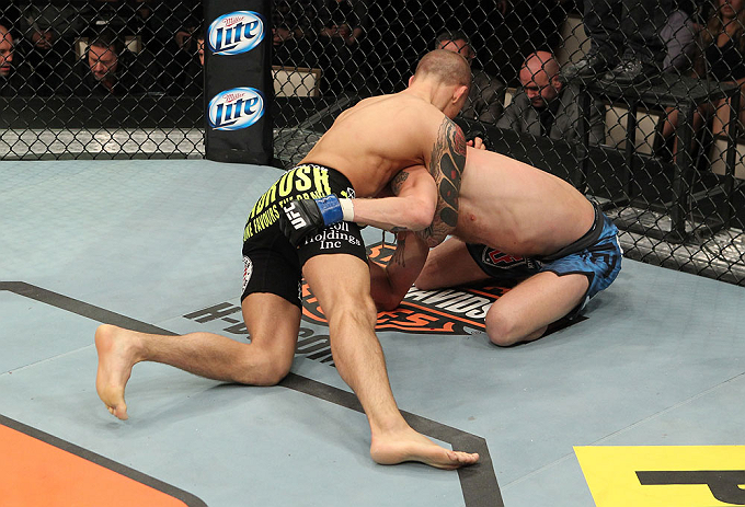 LAS VEGAS, NV - DECEMBER 15:  Dustin Poirier (black shorts) attempts to submit Jonathan Brookins during their featherweight fight at the TUF 16 Finale on December 15, 2012  at the Joint at the Hard Rock in Las Vegas, Nevada.  (Photo by Jim Kemper/Zuffa LLC/Zuffa LLC via Getty Images) *** Local Caption *** Dustn Poirier; Jonathan Brookins