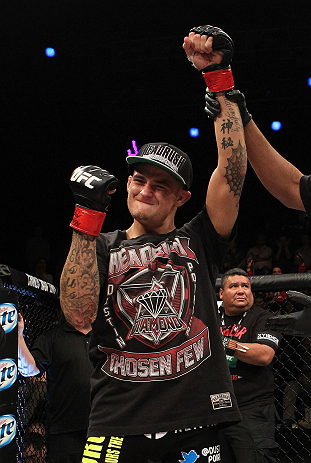 LAS VEGAS, NV - DECEMBER 15:  Dustin Poirier reacts to being declared the winner in his fight against Jonathan Brookins during their featherweight fight at the TUF 16 Finale on December 15, 2012  at the Joint at the Hard Rock in Las Vegas, Nevada.  (Photo by Jim Kemper/Zuffa LLC/Zuffa LLC via Getty Images) *** Local Caption *** Dustn Poirier; Jonathan Brookins