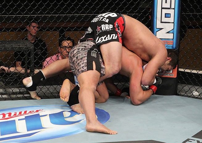 LAS VEGAS, NV - DECEMBER 15:  Shane Del Rosario (top) attempts to submit Pat Barry (bottom) during their heavyweight fight at the TUF 16 Finale on December 15, 2012  at the Joint at the Hard Rock in Las Vegas, Nevada.  (Photo by Jim Kemper/Zuffa LLC/Zuffa LLC via Getty Images) *** Local Caption *** Pat Barry; Shane Del Rosario
