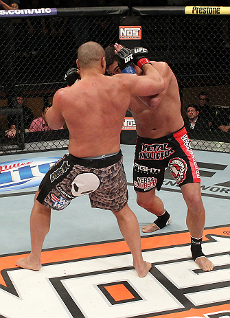 LAS VEGAS, NV - DECEMBER 15:  (L-R) Pat Barry punches Shane Del Rosario during their heavyweight fight at the TUF 16 Finale on December 15, 2012  at the Joint at the Hard Rock in Las Vegas, Nevada.  (Photo by Jim Kemper/Zuffa LLC/Zuffa LLC via Getty Images) *** Local Caption *** Pat Barry; Shane Del Rosario