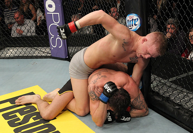 LAS VEGAS, NV - DECEMBER 15:  Colton Smith (top) punches Mike Ricci during their lightweight fight at the TUF 16 Finale on December 15, 2012  at the Joint at the Hard Rock in Las Vegas, Nevada.  (Photo by Jim Kemper/Zuffa LLC/Zuffa LLC via Getty Images) *** Local Caption *** Colton Smith; Mike Ricci