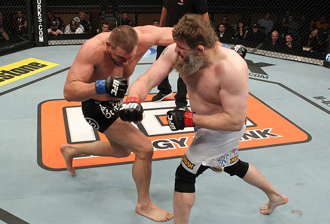 LAS VEGAS, NV - DECEMBER 15:  (R-L) Roy Nelson punches Matt Mitrione during their heavyweight fight at the TUF 16 Finale on December 15, 2012  at the Joint at the Hard Rock in Las Vegas, Nevada.  (Photo by Jim Kemper/Zuffa LLC/Zuffa LLC via Getty Images) *** Local Caption *** Roy Nelson; Matt Mitrione