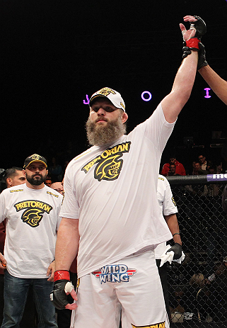 LAS VEGAS, NV - DECEMBER 15:  Roy Nelson reacts to being declared the winner over Matt Mitrione during their heavyweight fight at the TUF 16 Finale on December 15, 2012  at the Joint at the Hard Rock in Las Vegas, Nevada.  (Photo by Jim Kemper/Zuffa LLC/Zuffa LLC via Getty Images) *** Local Caption *** Roy Nelson; Shane Carwin