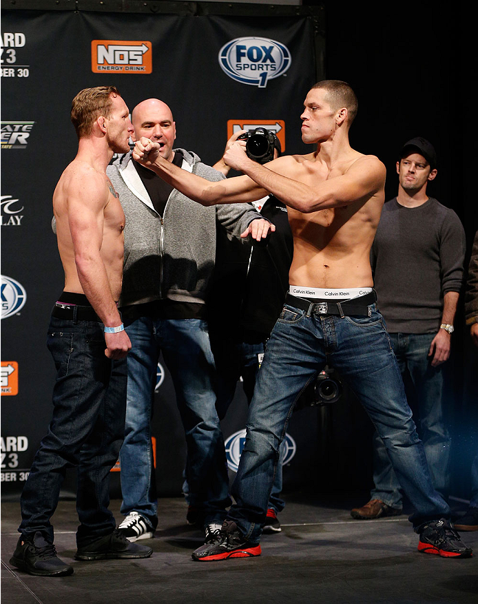LAS VEGAS, NV - NOVEMBER 29:  (L-R) Opponents Gray Maynard and Nate Diaz face off during the weigh-in for The Ultimate Fighter season 18 live finale inside the Mandalay Bay Events Center on November 29, 2013 in Las Vegas, Nevada. (Photo by Josh Hedges/Zuffa LLC/Zuffa LLC via Getty Images)