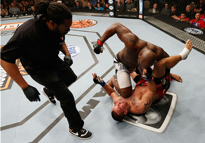 LAS VEGAS, NV - JULY 06:  Derrick Lewis (top) punches Guto Inocente in their heavyweight fight during the Ultimate Fighter Finale inside the Mandalay Bay Events Center on July 6, 2014 in Las Vegas, Nevada.  (Photo by Josh Hedges/Zuffa LLC/Zuffa LLC via Getty Images)