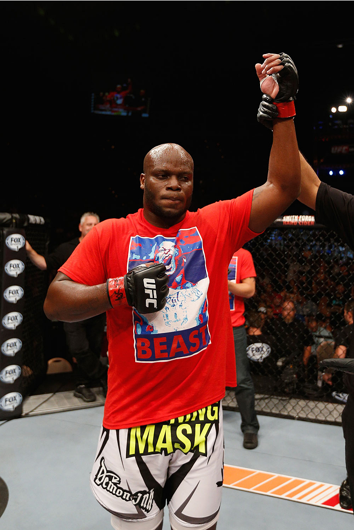LAS VEGAS, NV - JULY 06:  Derrick Lewis celebrates defeating Guto Inocente in their heavyweight fight during the Ultimate Fighter Finale inside the Mandalay Bay Events Center on July 6, 2014 in Las Vegas, Nevada.  (Photo by Josh Hedges/Zuffa LLC/Zuffa LLC via Getty Images)