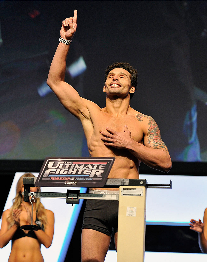 LAS VEGAS, NV - JULY 05: Mixed martial artist Adriano Martins poses on the scale during the TUF 19 Finale weigh-in at the Mandalay Bay Convention Center on July 5, 2014 in Las Vegas, Nevada. (Photo by David Becker/Zuffa LLC/Zuffa LLC via Getty Images)