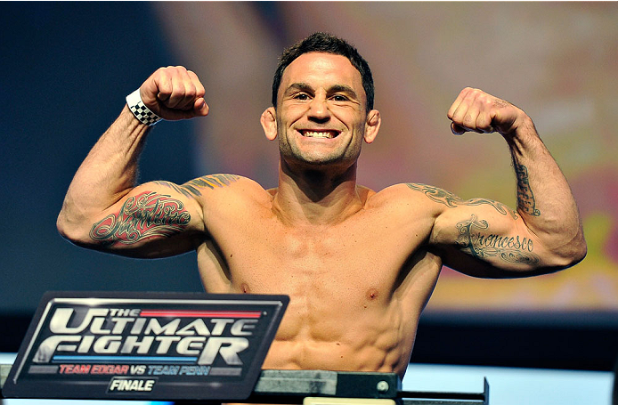 LAS VEGAS, NV - JULY 05:  Mixed martial artist Frankie Edgar poses on the scale during the TUF 19 Finale weigh-in at the Mandalay Bay Convention Center on July 5, 2014 in Las Vegas, Nevada.  (Photo by David Becker/Zuffa LLC/Zuffa LLC via Getty Images)