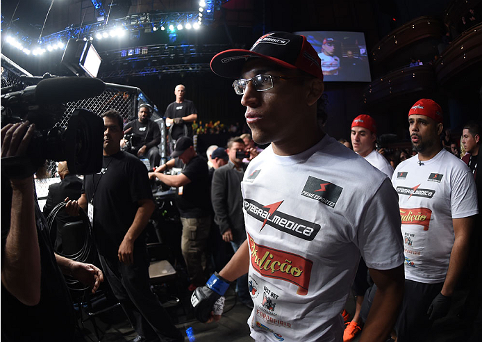 LAS VEGAS, NEVADA - DECEMBER 12:  Charles Oliveira prepares to enter the Octagon before facing Jeremy Stephens in their lightweight fight during The Ultimate Fighter Finale event inside the Pearl concert theater at the Palms Casino Resort on December 12, 2014 in Las Vegas, Nevada. (Photo by Jeff Bottari/Zuffa LLC/Zuffa LLC via Getty Images)