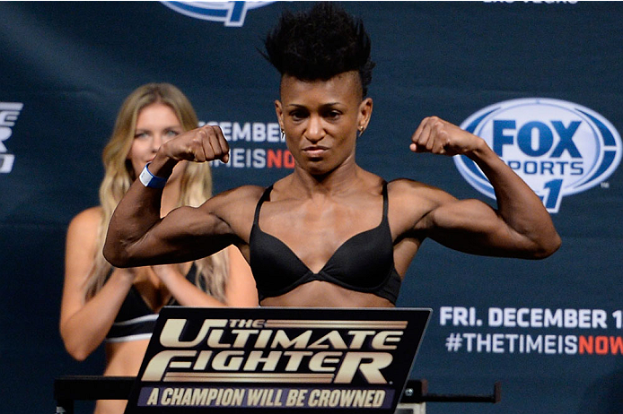 LAS VEGAS, NEVADA - DECEMBER 11:  UFC straight Angela Hill steps on the scale during The Ultimate Fighter Finale weigh-ins at the Palms Casino Resort on December 11, 2014 in Las Vegas, Nevada. (Photo by Jeff Bottari/Zuffa LLC/Zuffa LLC via Getty Images)