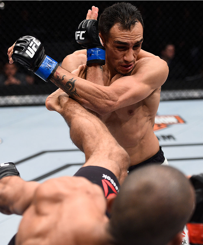 LAS VEGAS, NV - DECEMBER 11: Edson Barboza (bottom) kicks Tony Ferguson in their lightweight bout during the TUF Finale event inside The Chelsea at The Cosmopolitan of Las Vegas on December 11, 2015 in Las Vegas, Nevada.  (Photo by Jeff Bottari/Zuffa LLC/Zuffa LLC via Getty Images) *** Local Caption *** Edson Barboza; Tony Ferguson