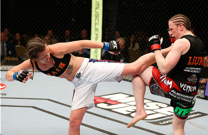 QUEBEC CITY, CANADA - APRIL 16:  (L-R) Leslie Smith kicks Sarah Kaufman in their women's bantamweight fight during the TUF Nations Finale at Colisee Pepsi on April 16, 2014 in Quebec City, Quebec, Canada. (Photo by Josh Hedges/Zuffa LLC/Zuffa LLC via Getty Images)