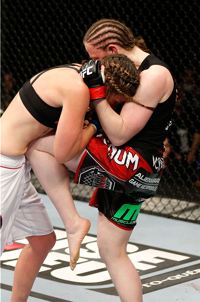 QUEBEC CITY, CANADA - APRIL 16:  (R-L) Sarah Kaufman knees Leslie Smith in their women's bantamweight fight during the TUF Nations Finale at Colisee Pepsi on April 16, 2014 in Quebec City, Quebec, Canada. (Photo by Josh Hedges/Zuffa LLC/Zuffa LLC via Getty Images)