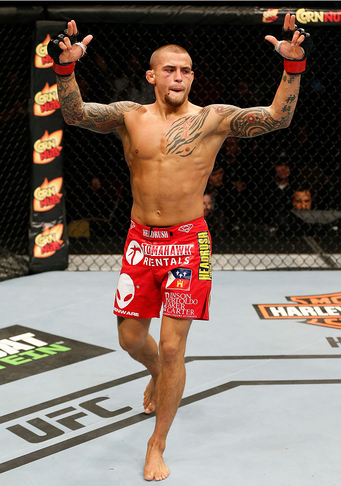 QUEBEC CITY, CANADA - APRIL 16:  Dustin Poirier reacts after his TKO victory over Akira Corassani in their featherweight fight during the TUF Nations Finale at Colisee Pepsi on April 16, 2014 in Quebec City, Quebec, Canada. (Photo by Josh Hedges/Zuffa LLC/Zuffa LLC via Getty Images)