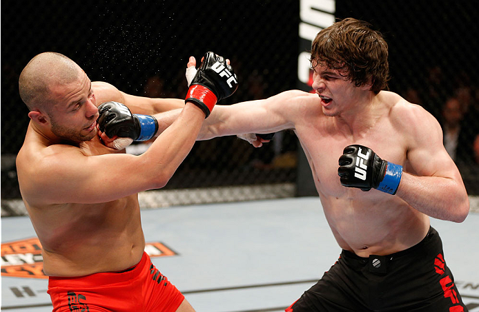 QUEBEC CITY, CANADA - APRIL 16:  (R-L) Olivier Aubin-Mercier punches Chad Laprise in their welterweight fight during the TUF Nations Finale at Colisee Pepsi on April 16, 2014 in Quebec City, Quebec, Canada. (Photo by Josh Hedges/Zuffa LLC/Zuffa LLC via Getty Images)