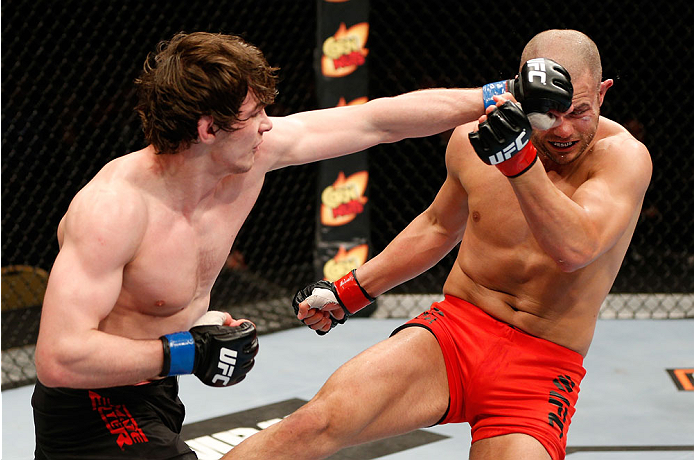 QUEBEC CITY, CANADA - APRIL 16:  (L-R) Olivier Aubin-Mercier punches Chad Laprise in their welterweight fight during the TUF Nations Finale at Colisee Pepsi on April 16, 2014 in Quebec City, Quebec, Canada. (Photo by Josh Hedges/Zuffa LLC/Zuffa LLC via Getty Images)