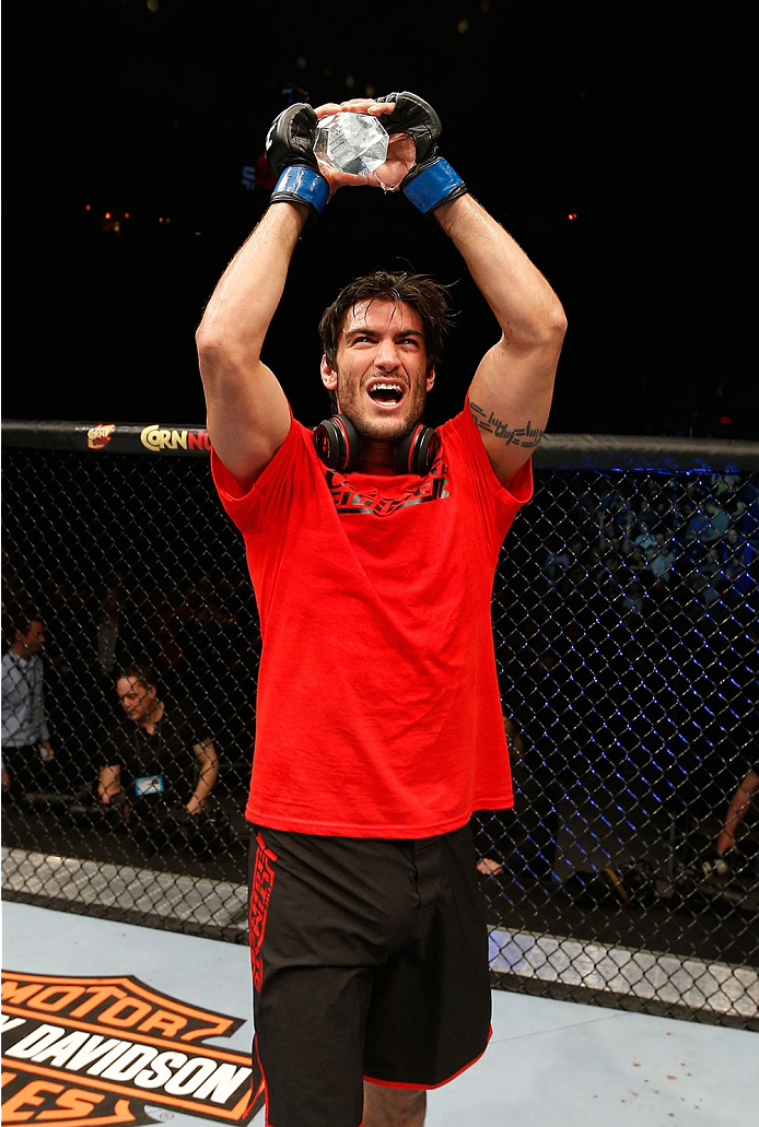 QUEBEC CITY, CANADA - APRIL 16:  Elias Theodorou reacts after his TKO victory over Sheldon Westcott in their middleweight fight during the TUF Nations Finale at Colisee Pepsi on April 16, 2014 in Quebec City, Quebec, Canada. (Photo by Josh Hedges/Zuffa LLC/Zuffa LLC via Getty Images)