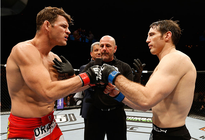 QUEBEC CITY, CANADA - APRIL 16:  (L-R) Opponents Michael Bisping and Tim Kennedy face off before their middleweight fight during the TUF Nations Finale at Colisee Pepsi on April 16, 2014 in Quebec City, Quebec, Canada. (Photo by Josh Hedges/Zuffa LLC/Zuffa LLC via Getty Images)