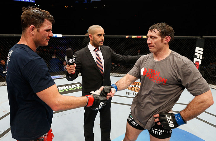 QUEBEC CITY, CANADA - APRIL 16:  Michael Bisping (L) congratulates Tim Kennedy on his decision victory after their middleweight fight during the TUF Nations Finale at Colisee Pepsi on April 16, 2014 in Quebec City, Quebec, Canada. (Photo by Josh Hedges/Zuffa LLC/Zuffa LLC via Getty Images)