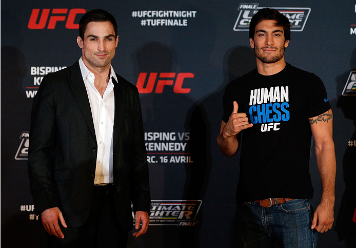 QUEBEC CITY, CANADA - APRIL 14:  (L-R) Opponents Sheldon Wescott and Elias Theodorou pose for photos during the UFC Ultimate Media Day at the TRYP Quebec Hotel on April 14, 2014 in Quebec City, Quebec, Canada. (Photo by Josh Hedges/Zuffa LLC/Zuffa LLC via Getty Images)