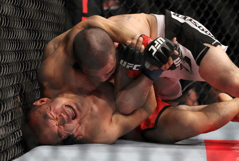 SAITAMA, JAPAN - FEBRUARY 26:  (L-R) Tiequan Zhang struggles to regain position on the ground against Issei Tamura during the UFC 144 event at Saitama Super Arena on February 26, 2012 in Saitama, Japan.  (Photo by Josh Hedges/Zuffa LLC/Zuffa LLC via Getty Images) *** Local Caption *** Tiequan Zhang; Issei Tamura