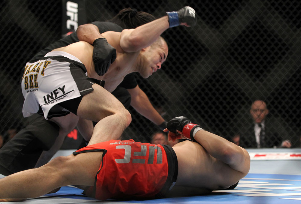SAITAMA, JAPAN - FEBRUARY 26:  (L-R) Issei Tamura knocks out Tiequan Zhang with a punch on the ground during the UFC 144 event at Saitama Super Arena on February 26, 2012 in Saitama, Japan.  (Photo by Josh Hedges/Zuffa LLC/Zuffa LLC via Getty Images) *** Local Caption *** Tiequan Zhang; Issei Tamura