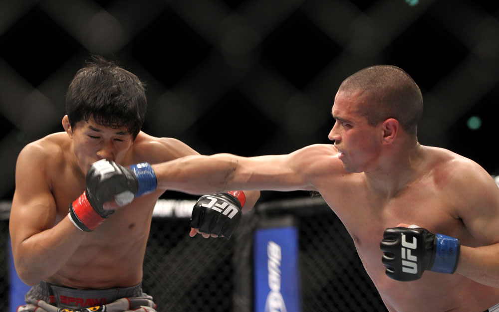 SAITAMA, JAPAN - FEBRUARY 26:  (R-L) Chris Cariaso punches Takeya Mizugaki during the UFC 144 event at Saitama Super Arena on February 26, 2012 in Saitama, Japan.  (Photo by Josh Hedges/Zuffa LLC/Zuffa LLC via Getty Images) *** Local Caption *** Takeya Mizugaki; Chris Cariaso