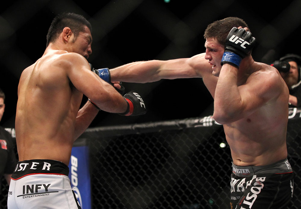 SAITAMA, JAPAN - FEBRUARY 26:  (R-L) Steve Cantwell punches Riki Fukuda during the UFC 144 event at Saitama Super Arena on February 26, 2012 in Saitama, Japan.  (Photo by Josh Hedges/Zuffa LLC/Zuffa LLC via Getty Images) *** Local Caption *** Riki Fukuda; Steve Cantwell