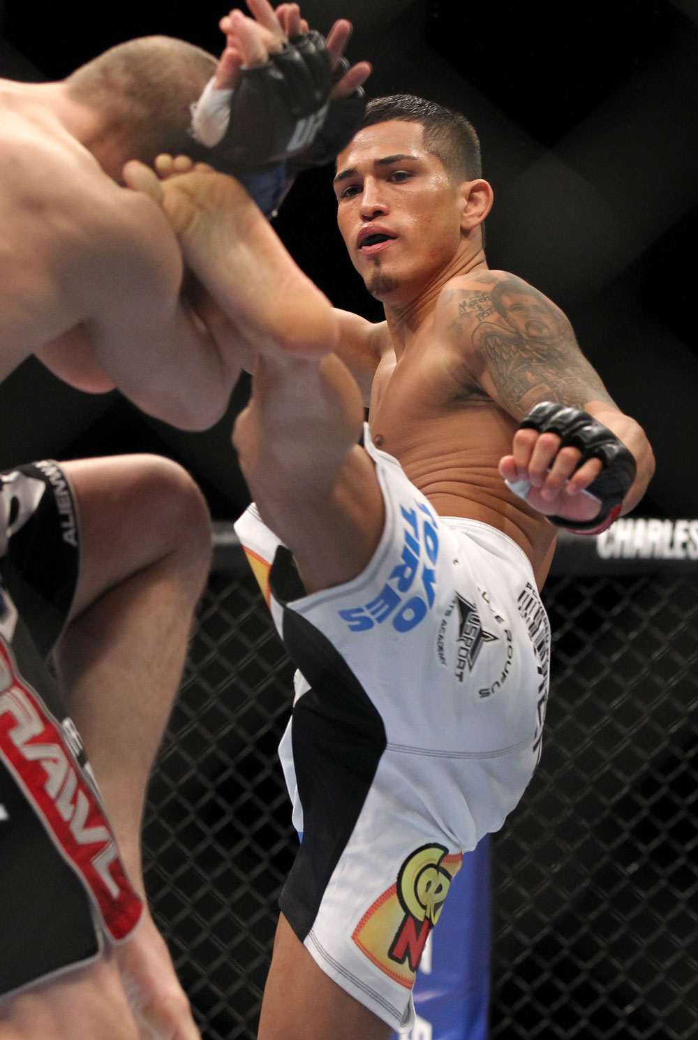 SAITAMA, JAPAN - FEBRUARY 26:  (R-L) Anthony Pettis kicks Joe Lauzon during the UFC 144 event at Saitama Super Arena on February 26, 2012 in Saitama, Japan.  (Photo by Josh Hedges/Zuffa LLC/Zuffa LLC via Getty Images) *** Local Caption *** Anthony Pettis; Joe Lauzon