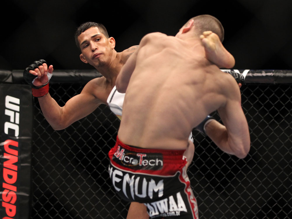 SAITAMA, JAPAN - FEBRUARY 26:  (L-R) Anthony Pettis knocks out Joe Lauzon with a kick during the UFC 144 event at Saitama Super Arena on February 26, 2012 in Saitama, Japan.  (Photo by Josh Hedges/Zuffa LLC/Zuffa LLC via Getty Images) *** Local Caption *** Anthony Pettis; Joe Lauzon