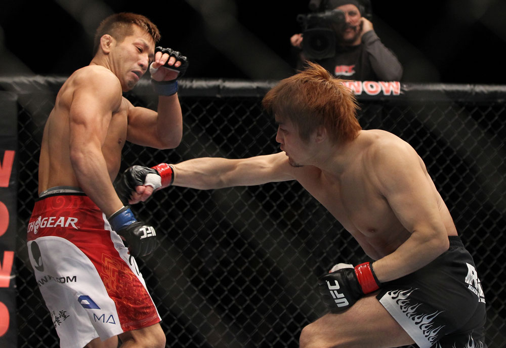 SAITAMA, JAPAN - FEBRUARY 26:  (R-L) Takanori Gomi punches Eiji Mitsuoka during the UFC 144 event at Saitama Super Arena on February 26, 2012 in Saitama, Japan.  (Photo by Josh Hedges/Zuffa LLC/Zuffa LLC via Getty Images) *** Local Caption *** Takanori Gomi; Eiji Mitsuoka