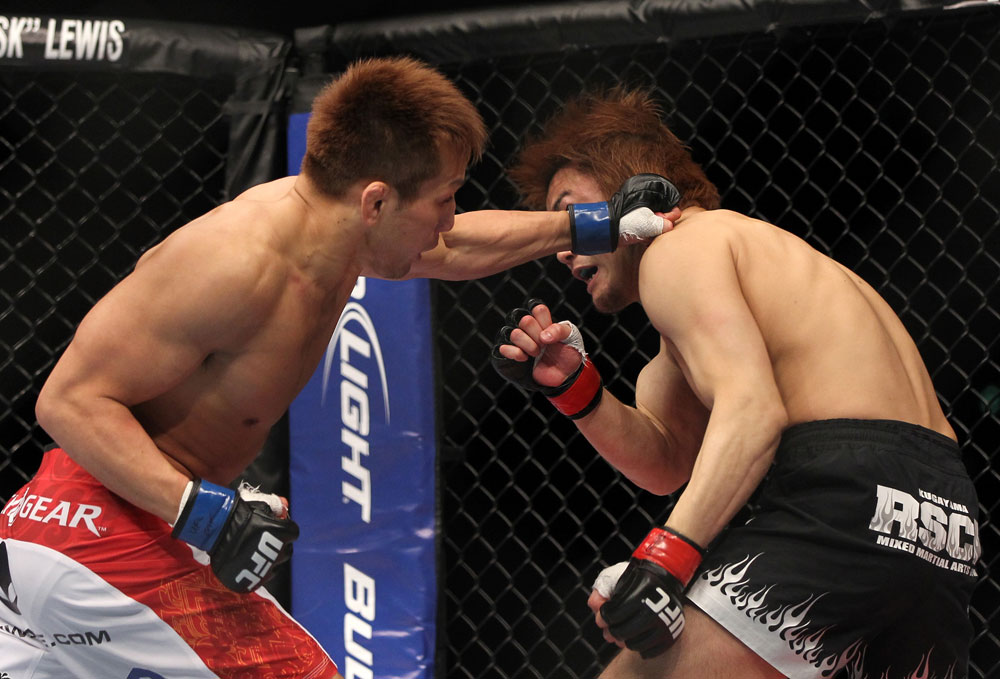 SAITAMA, JAPAN - FEBRUARY 26:  (L-R) Eiji Mitsuoka punches Takanori Gomi during the UFC 144 event at Saitama Super Arena on February 26, 2012 in Saitama, Japan.  (Photo by Josh Hedges/Zuffa LLC/Zuffa LLC via Getty Images) *** Local Caption *** Takanori Gomi; Eiji Mitsuoka