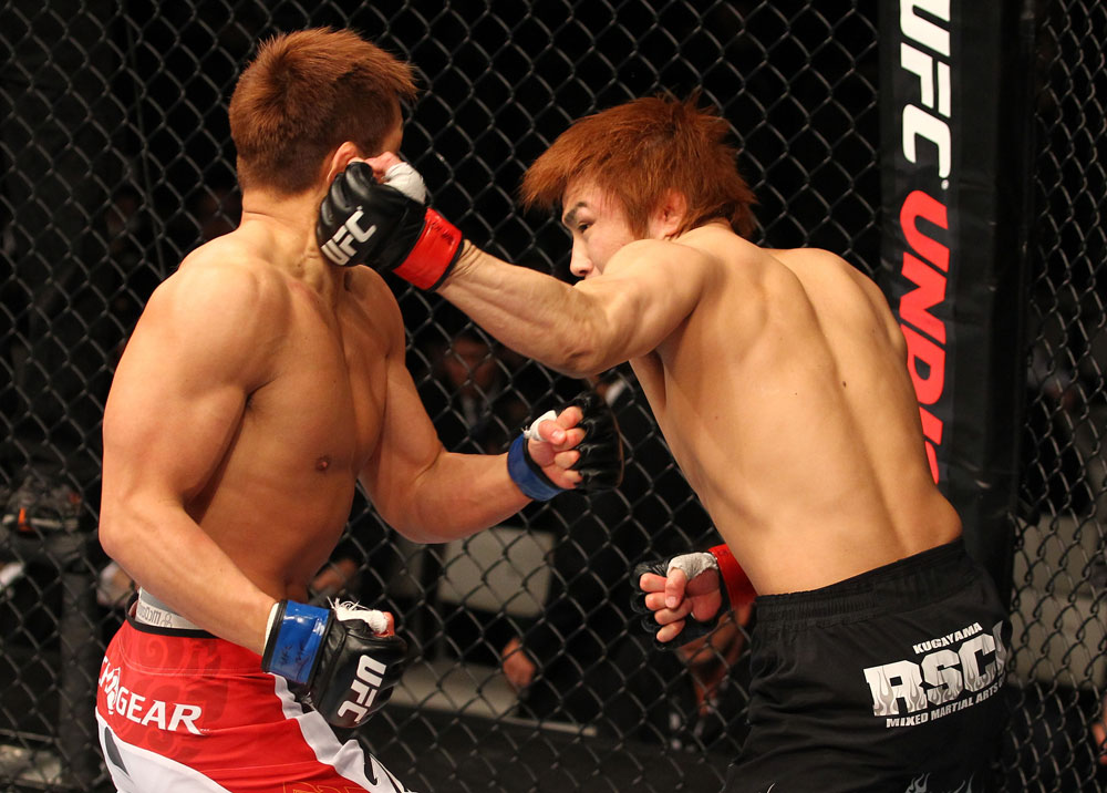 SAITAMA, JAPAN - FEBRUARY 26:  (R-L) Takanori Gomi punches Eiji Mitsuoka during the UFC 144 event at Saitama Super Arena on February 26, 2012 in Saitama, Japan.  (Photo by Al Bello/Zuffa LLC/Zuffa LLC via Getty Images) *** Local Caption *** Takanori Gomi; Eiji Mitsuoka