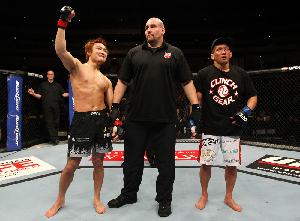 SAITAMA, JAPAN - FEBRUARY 26:  Takanori Gomi (L) reacts after defeating Eiji Mitsuoka by TKO during the UFC 144 event at Saitama Super Arena on February 26, 2012 in Saitama, Japan.  (Photo by Al Bello/Zuffa LLC/Zuffa LLC via Getty Images) *** Local Caption *** Takanori Gomi; Eiji Mitsuoka