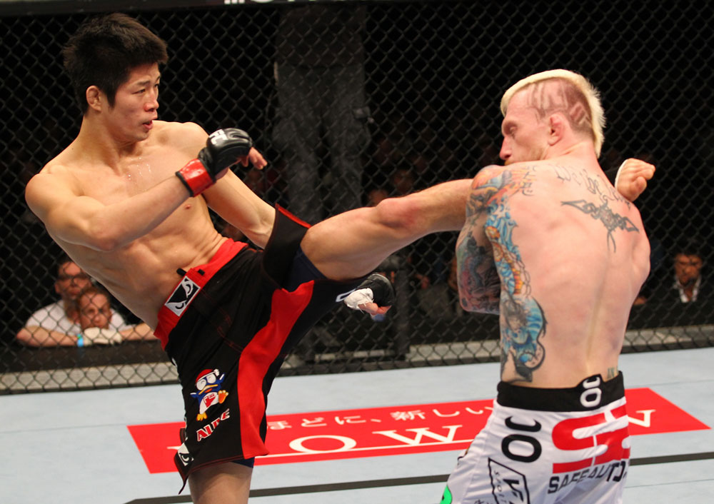SAITAMA, JAPAN - FEBRUARY 26:  (L-R) Hatsu Hioki kicks Bart Palaszewski during the UFC 144 event at Saitama Super Arena on February 26, 2012 in Saitama, Japan.  (Photo by Al Bello/Zuffa LLC/Zuffa LLC via Getty Images) *** Local Caption *** Hatsu Hioki; Bart Palaszewski