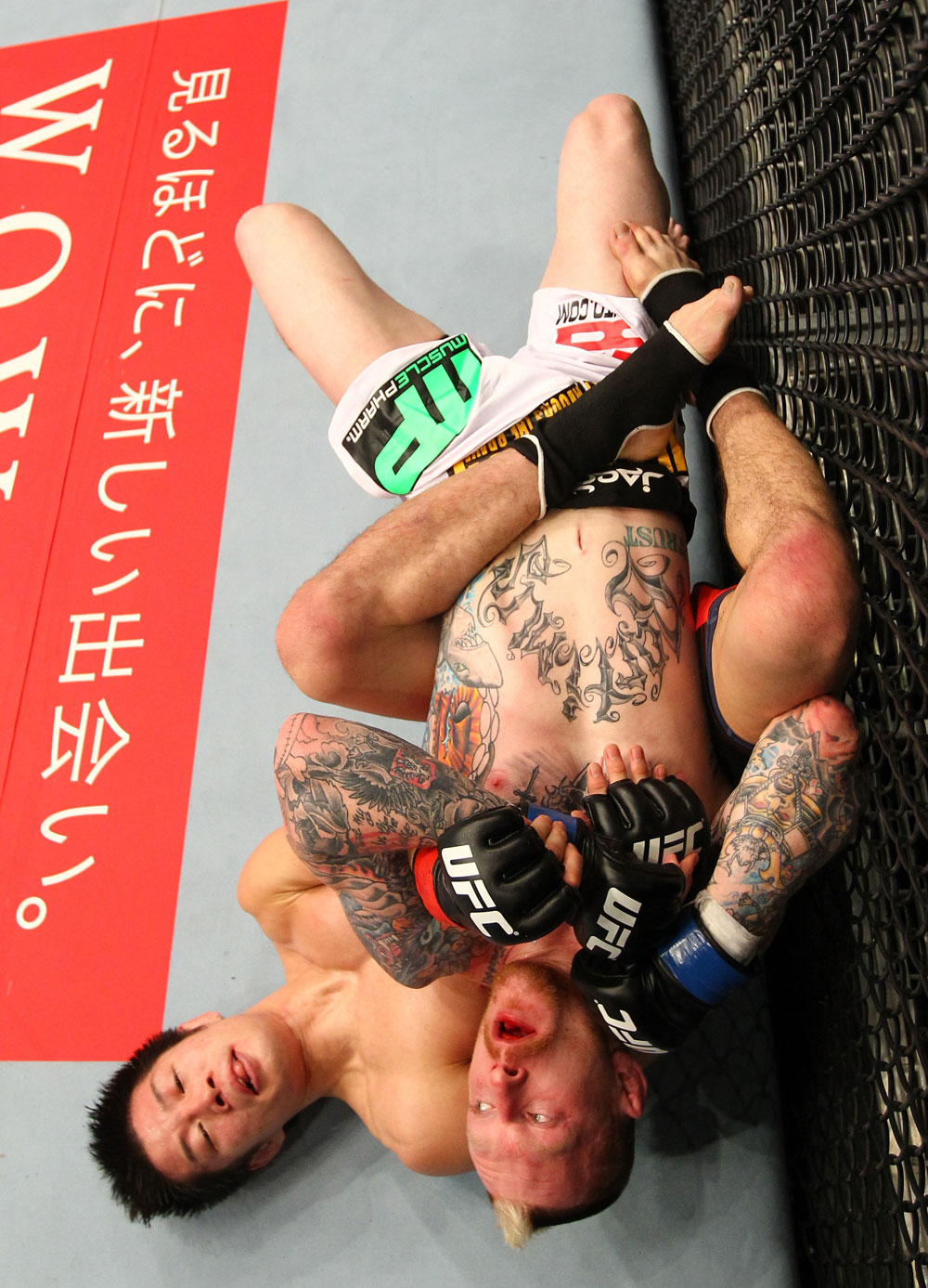 SAITAMA, JAPAN - FEBRUARY 26:  (L-R) Hatsu Hioki attempts to secure a submission hold against Bart Palaszewski during the UFC 144 event at Saitama Super Arena on February 26, 2012 in Saitama, Japan.  (Photo by Al Bello/Zuffa LLC/Zuffa LLC via Getty Images) *** Local Caption *** Hatsu Hioki; Bart Palaszewski