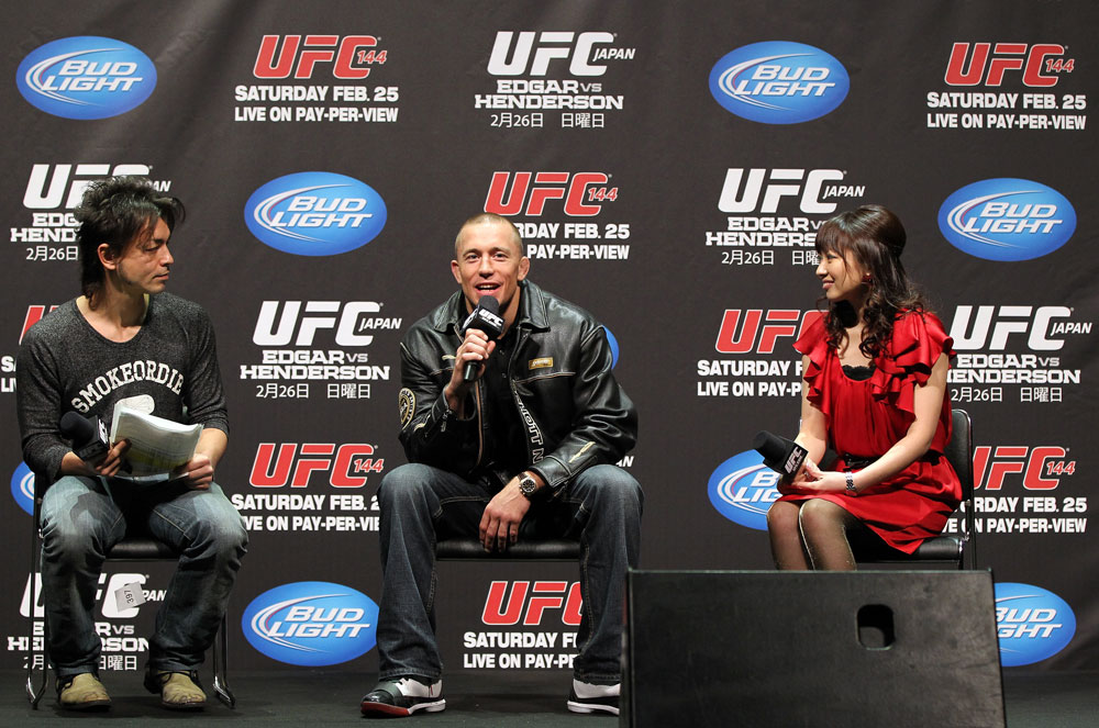 SAITAMA, JAPAN - FEBRUARY 25:  UFC Welterweight Champion Georges St-Pierre (center) takes part in a Q&A session before the official UFC 144 weigh in at the Saitama Super Arena on February 25, 2012 in Saitama, Japan.  (Photo by Josh Hedges/Zuffa LLC/Zuffa LLC via Getty Images) *** Local Caption *** Georges St-Pierre