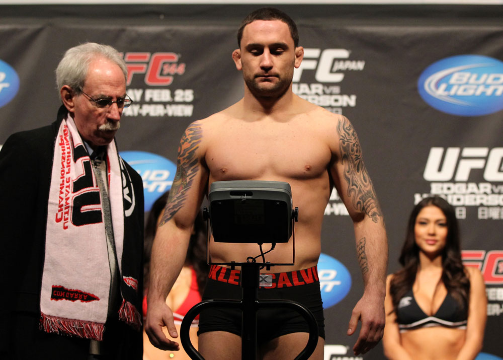 SAITAMA, JAPAN - FEBRUARY 25:  UFC Lightweight Champion Frankie Edgar weighs in during the official UFC 144 weigh in at the Saitama Super Arena on February 25, 2012 in Saitama, Japan.  (Photo by Josh Hedges/Zuffa LLC/Zuffa LLC via Getty Images) *** Local Caption *** Frankie Edgar