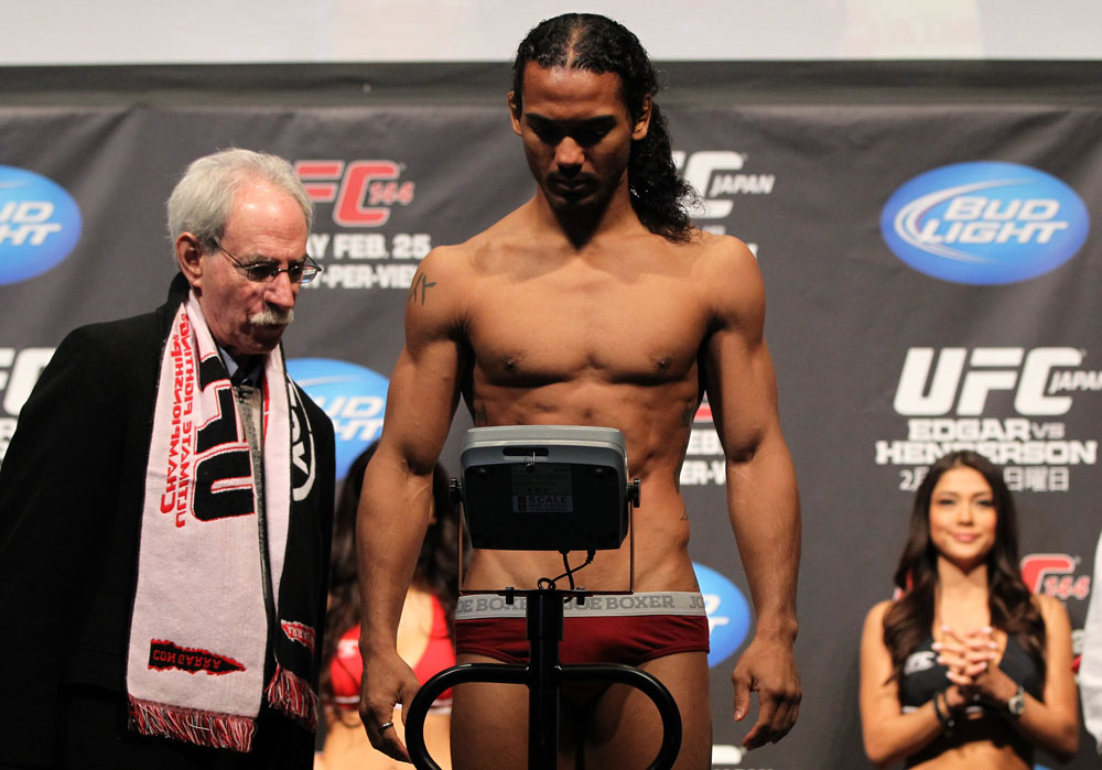 SAITAMA, JAPAN - FEBRUARY 25:  UFC Lightweight title challenger Benson Henderson weighs in during the official UFC 144 weigh in at the Saitama Super Arena on February 25, 2012 in Saitama, Japan.  (Photo by Josh Hedges/Zuffa LLC/Zuffa LLC via Getty Images) *** Local Caption *** Benson Henderson