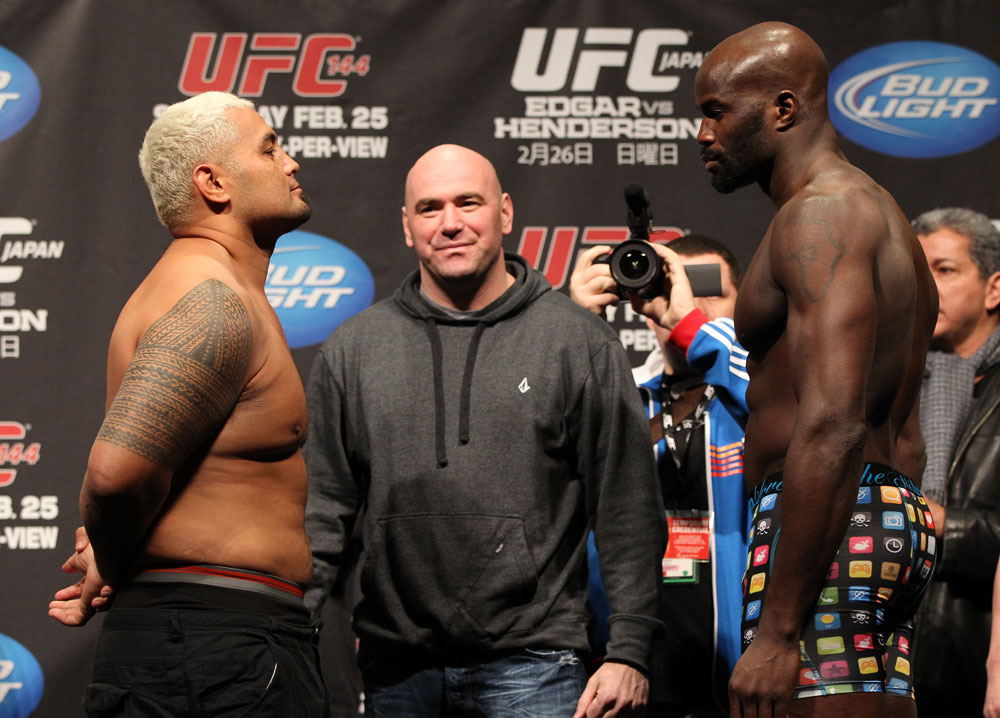 SAITAMA, JAPAN - FEBRUARY 25:  (L-R) Heavyweight opponents Mark Hunt and Cheick Kongo face off after weighing in during the official UFC 144 weigh in at the Saitama Super Arena on February 25, 2012 in Saitama, Japan.  (Photo by Josh Hedges/Zuffa LLC/Zuffa LLC via Getty Images) *** Local Caption *** Mark Hunt; Cheick Kongo; Dana White