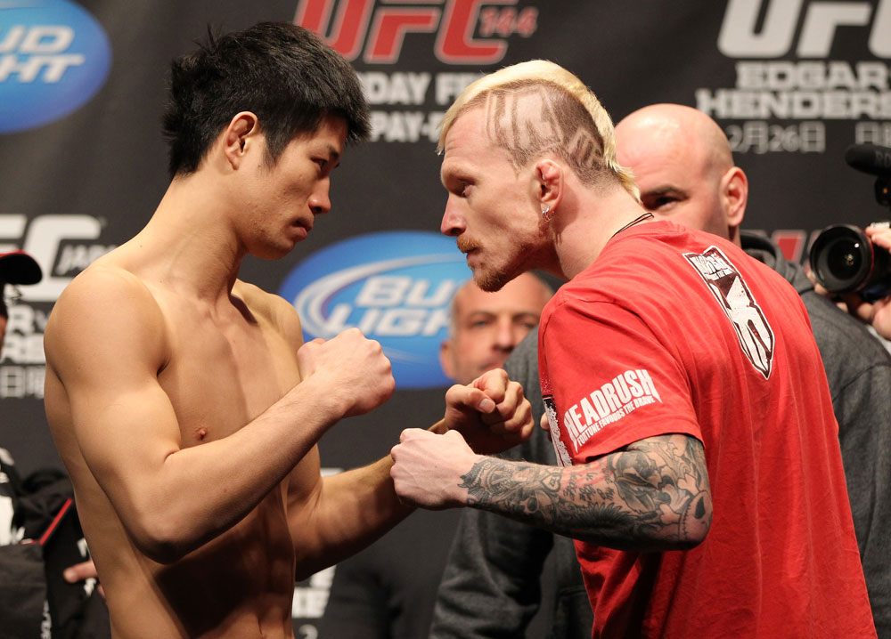 SAITAMA, JAPAN - FEBRUARY 25:  (L-R) Opponents Hatsu Hioki and Bart Palaszewski face off after weighing in during the official UFC 144 weigh in at the Saitama Super Arena on February 25, 2012 in Saitama, Japan.  (Photo by Josh Hedges/Zuffa LLC/Zuffa LLC via Getty Images) *** Local Caption *** Hatsu Hioki; Bart Palaszewski