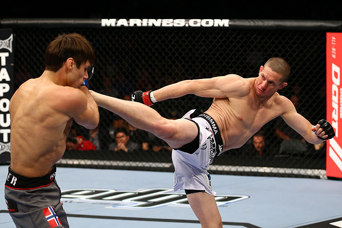 TORONTO, CANADA - SEPTEMBER 22: (R-L) Seth Baczynski kicks Simeon Thoresen during their welterweight bout at UFC 152 inside Air Canada Centre on September 22, 2012 in Toronto, Ontario, Canada. (Photo by Al Bello/Zuffa LLC/Zuffa LLC via Getty Images)