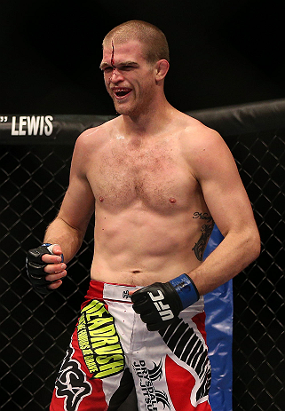 TORONTO, CANADA - SEPTEMBER 22: Evan Dunham smiles after receiving a punch from T.J. Grant during their lightweight bout at UFC 152 inside Air Canada Centre on September 22, 2012 in Toronto, Ontario, Canada. (Photo by Josh Hedges/Zuffa LLC/Zuffa LLC via Getty Images)