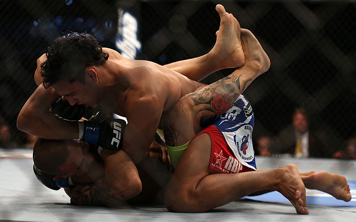 TORONTO, CANADA - SEPTEMBER 22: (R-L) Charles Oliveira delivers an elbow against Cub Swanson during their featherweight bout at UFC 152 inside Air Canada Centre on September 22, 2012 in Toronto, Ontario, Canada. (Photo by Josh Hedges/Zuffa LLC/Zuffa LLC via Getty Images)