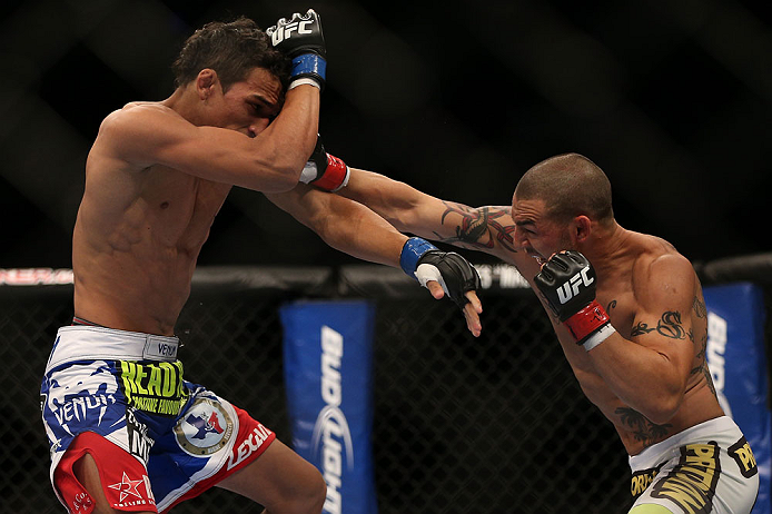 TORONTO, CANADA - SEPTEMBER 22: (R-L) Cub Swanson punches Charles Oliveira during their featherweight bout at UFC 152 inside Air Canada Centre on September 22, 2012 in Toronto, Ontario, Canada. (Photo by Josh Hedges/Zuffa LLC/Zuffa LLC via Getty Images)