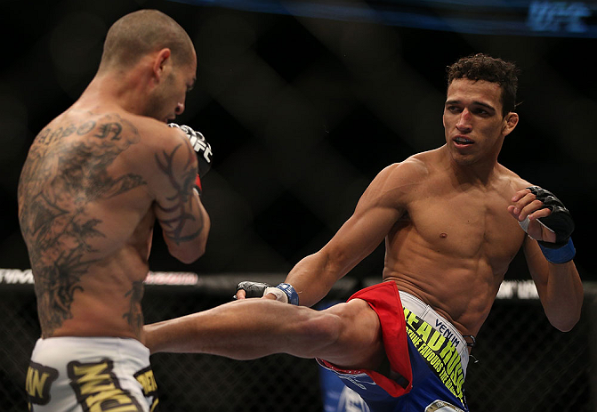 TORONTO, CANADA - SEPTEMBER 22: (R-L) Charles Oliveira kicks Cub Swanson during their featherweight bout at UFC 152 inside Air Canada Centre on September 22, 2012 in Toronto, Ontario, Canada. (Photo by Josh Hedges/Zuffa LLC/Zuffa LLC via Getty Images)