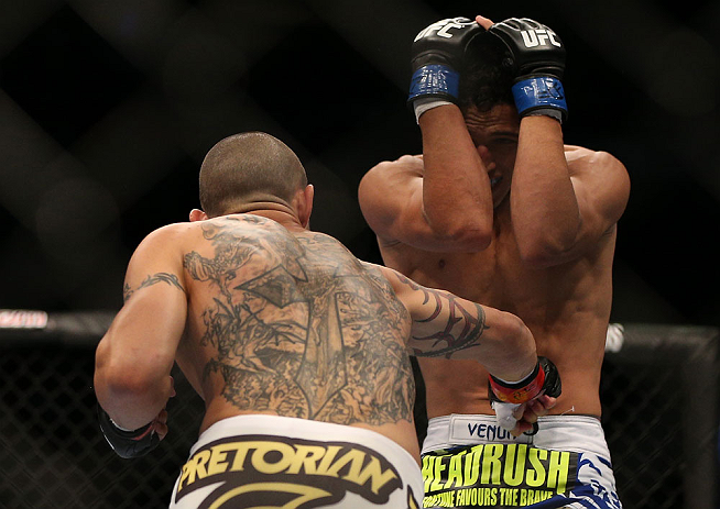 TORONTO, CANADA - SEPTEMBER 22: (L-R) Cub Swanson punches to the body of Charles Oliveira during their featherweight bout at UFC 152 inside Air Canada Centre on September 22, 2012 in Toronto, Ontario, Canada. (Photo by Josh Hedges/Zuffa LLC/Zuffa LLC via Getty Images)