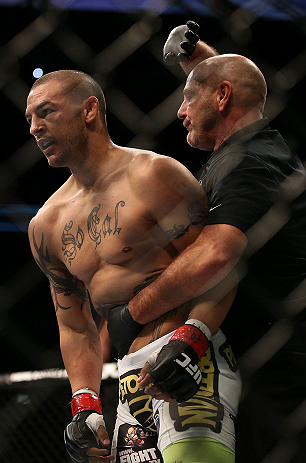 TORONTO, CANADA - SEPTEMBER 22: (R-L) Referee Yves Lavigne pulls Cub Swanson away after his knockout of Charles Oliveira during their featherweight bout at UFC 152 inside Air Canada Centre on September 22, 2012 in Toronto, Ontario, Canada. (Photo by Josh Hedges/Zuffa LLC/Zuffa LLC via Getty Images)