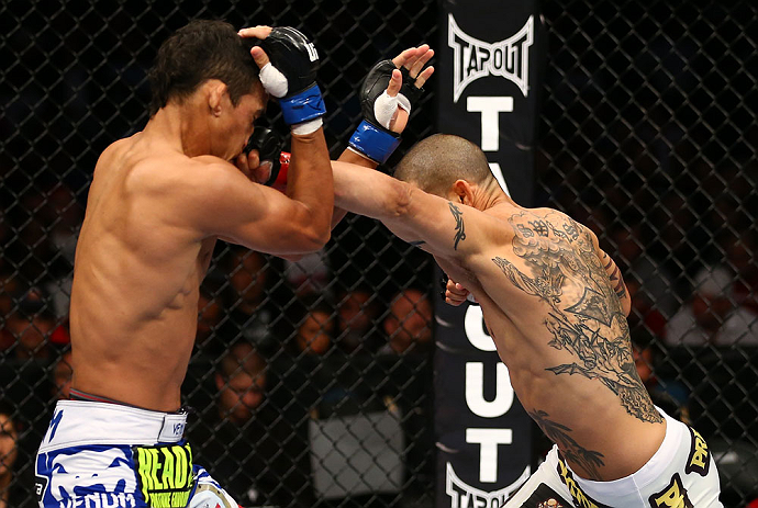 TORONTO, CANADA - SEPTEMBER 22:    (R-L) Cub Swanson punches Charles Oliveira during their featherweight bout at UFC 152 inside Air Canada Centre on September 22, 2012 in Toronto, Ontario, Canada.  (Photo by Al Bello/Zuffa LLC/Zuffa LLC via Getty Images)